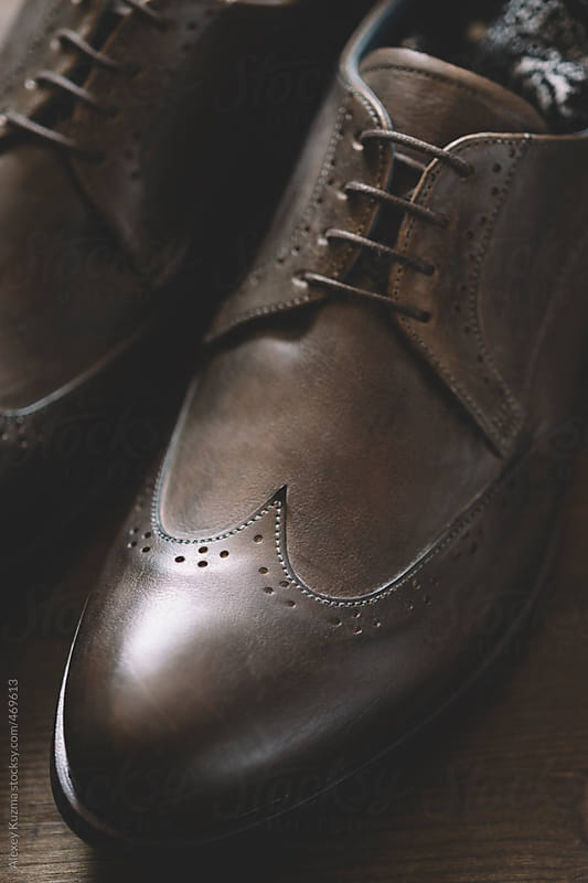Leather shoes and socks in closeup by Alexey Kuzma for Stocksy United