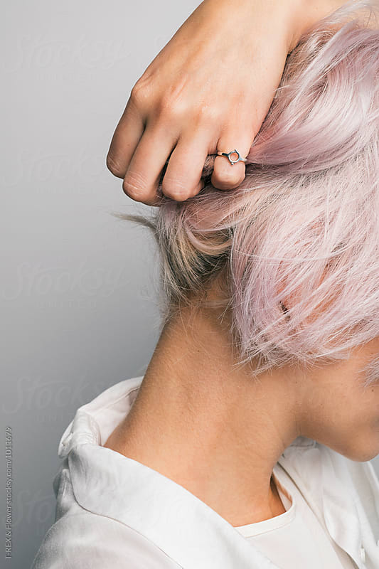 Close-up of unrecognizable girl holding pink hair by Danil Nevsky for Stocksy United