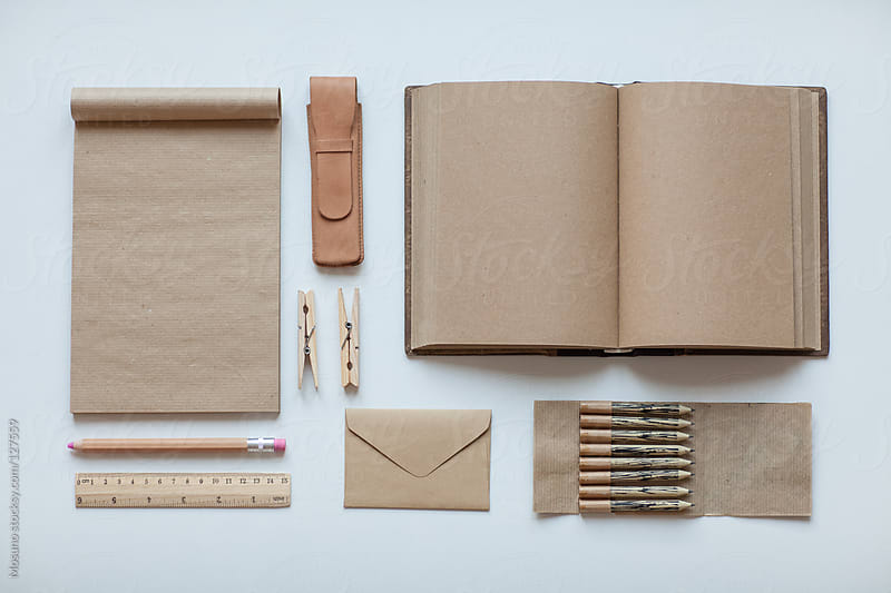 Office supplies arranged on a white table. by Mosuno for Stocksy United