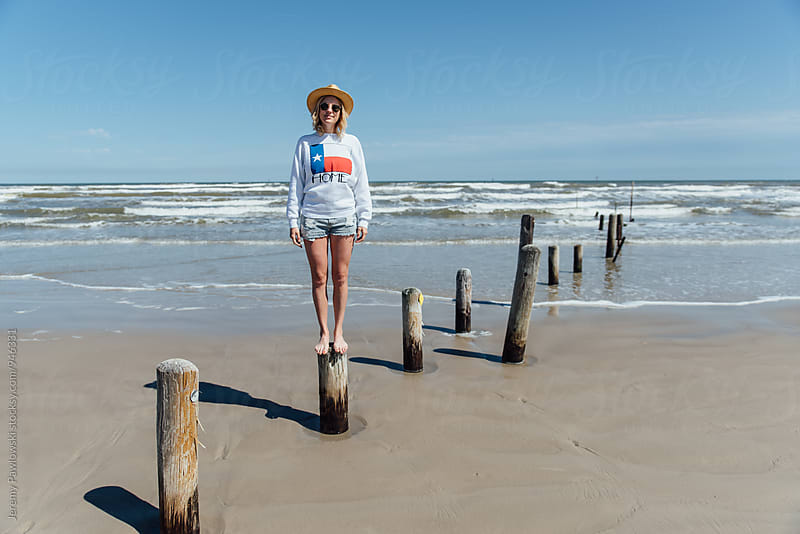Beautiful young woman with ocean waves, Gulf Coast, Texas by Jeremy Pawlowski for Stocksy United