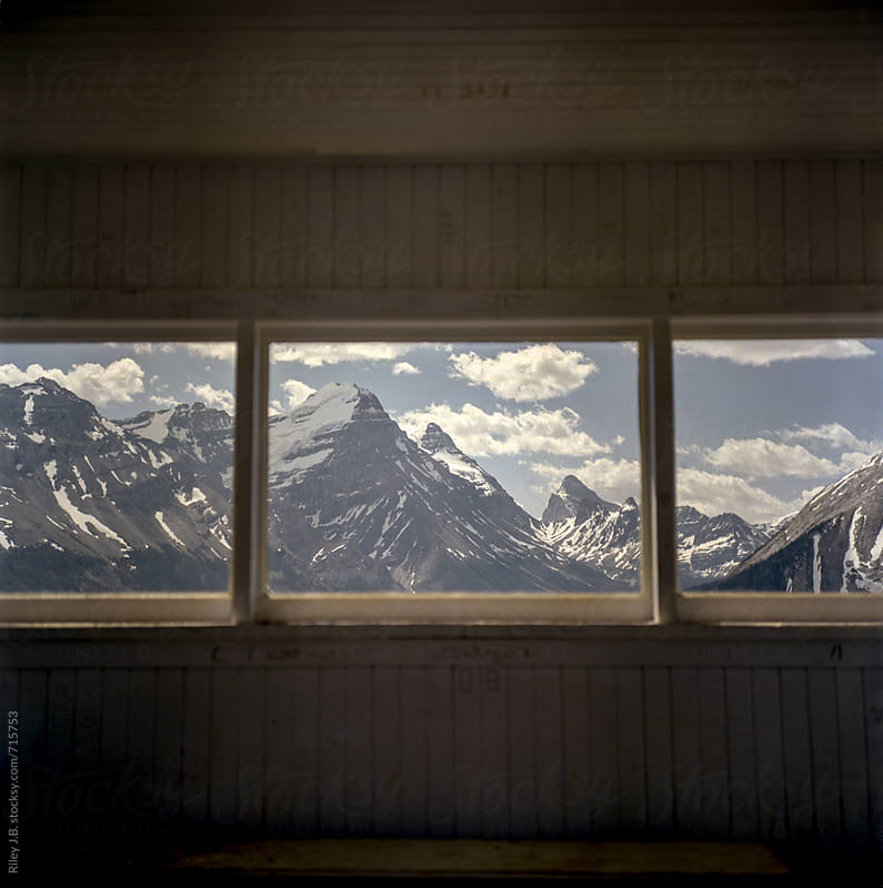 A view of the Rocky Mountains from a scenic lookout cabin by Riley J.B. for Stocksy United