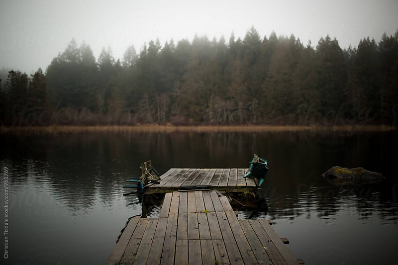 Old Dock on a lonely lake in the fog by Christian Tisdale for Stocksy United