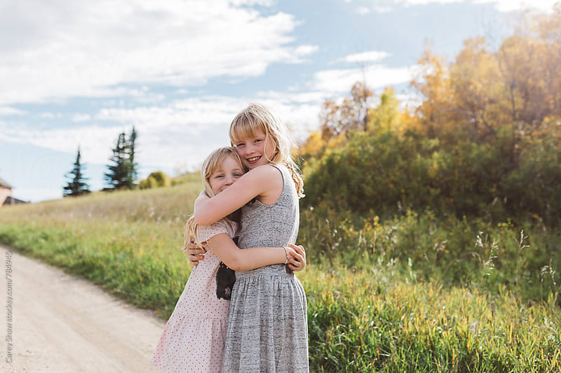 Young sisters hugging by Carey Shaw for Stocksy United