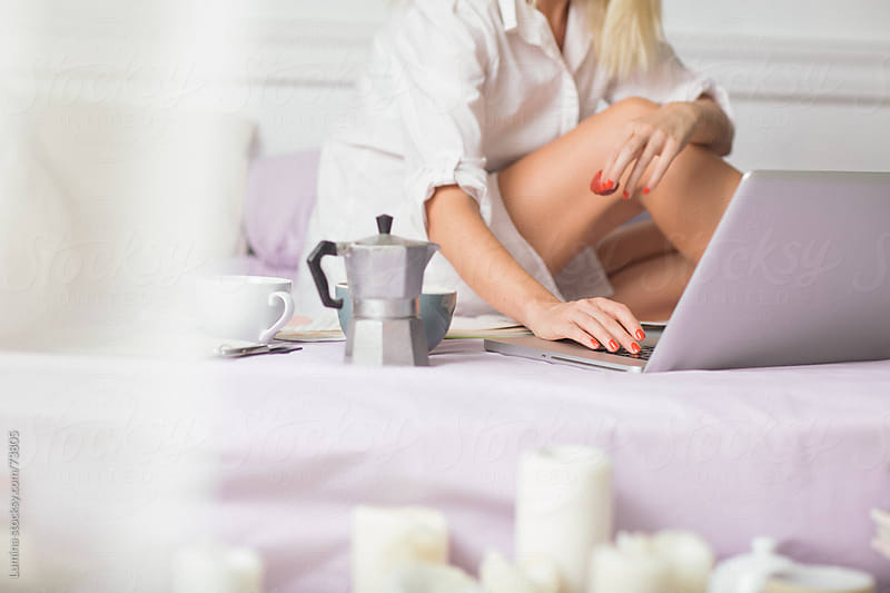 Woman Using Her Laptop in Bed by Lumina for Stocksy United