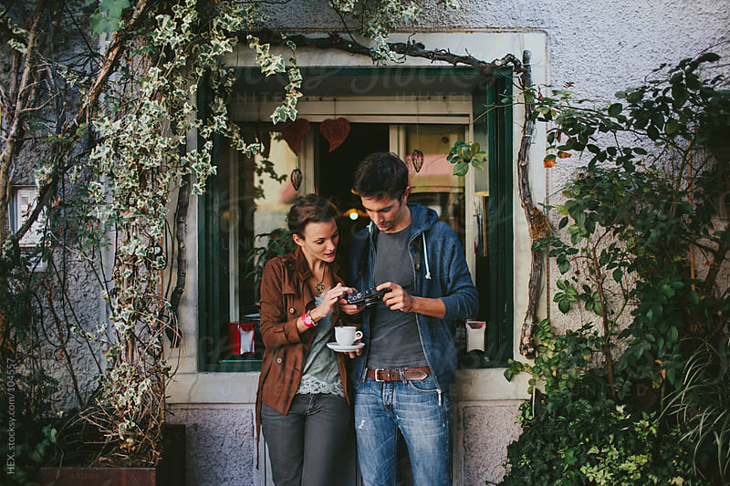 Young Couple is Using Camera by HEX. for Stocksy United