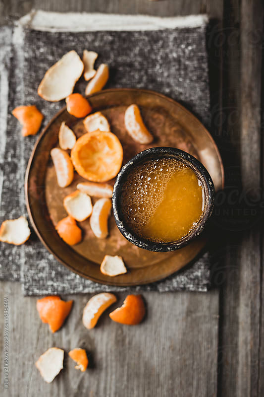 Tangerine juice by Tatjana Ristanic for Stocksy United