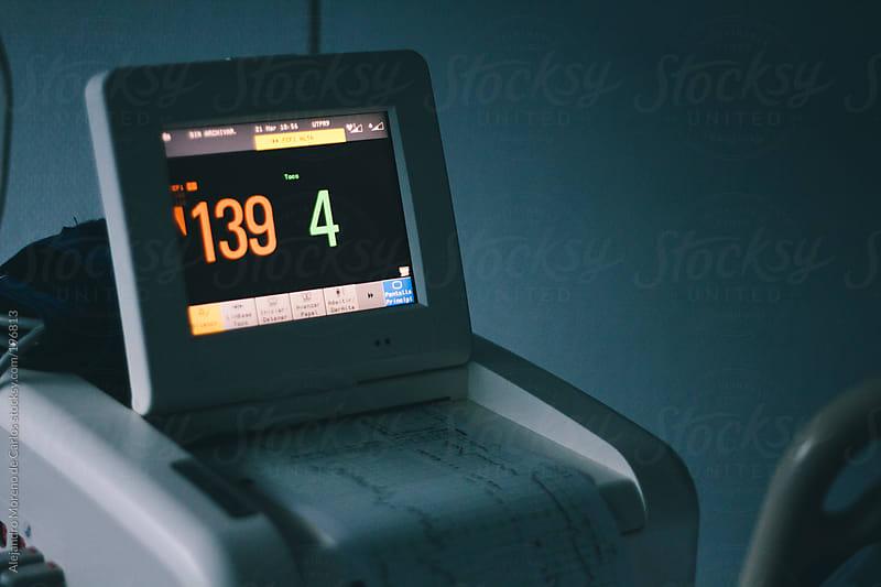 Medical equipment measuring vital signs at hospital by Alejandro Moreno de Carlos for Stocksy United