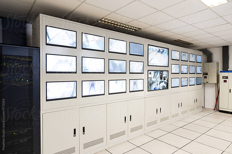 Security control room with monitors by Maa Hoo for Stocksy United