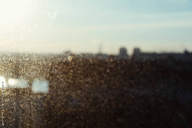 Blurred dust and city in the background by Boris Jovanovic for Stocksy United
