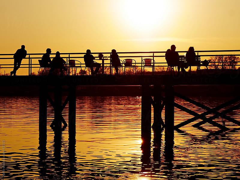 dock sunset people joy by rolfo for Stocksy United