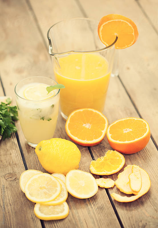 Freshly made citrus juice. by Mosuno for Stocksy United