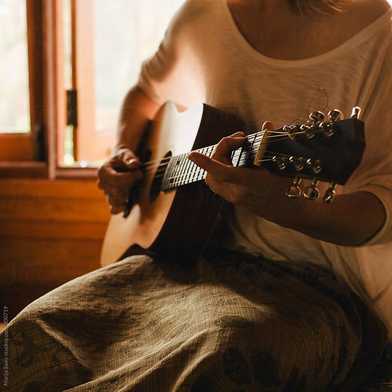 Woman Playing Guitar  by Marija Savic for Stocksy United