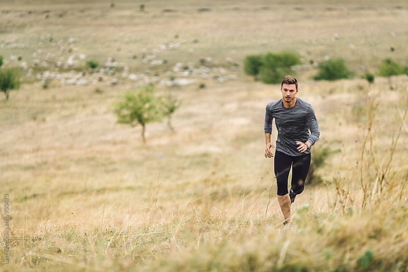 Man Running Outdoors by Lumina for Stocksy United