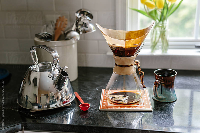 Coffee brewing on kitchen counter by Matthew Spaulding for Stocksy United
