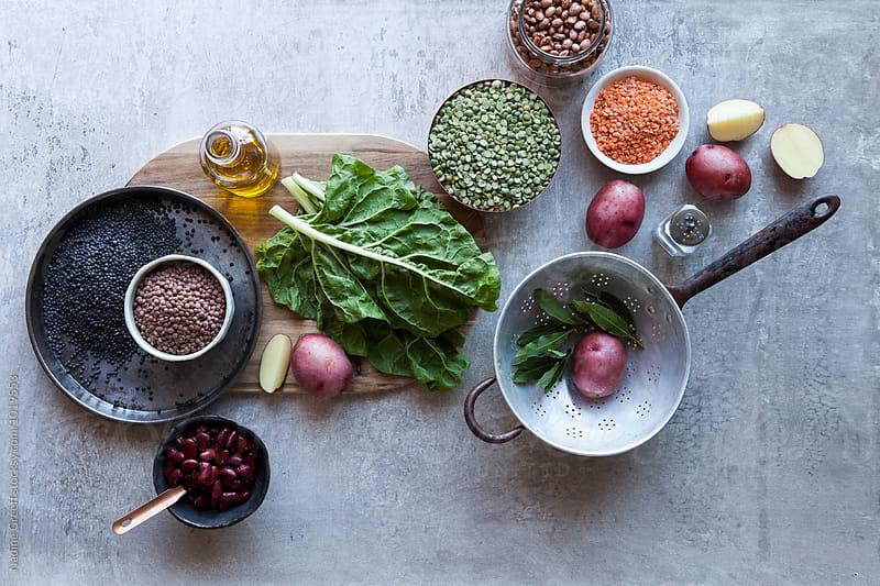 Pulses, dried beans, legumes, lentils and vegetables  by Nadine Greeff for Stocksy United