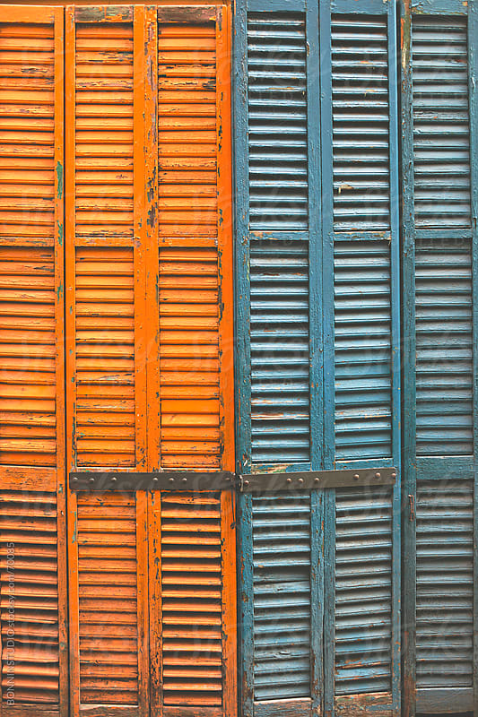 Orange and blue old wood painted blind. by BONNINSTUDIO for Stocksy United