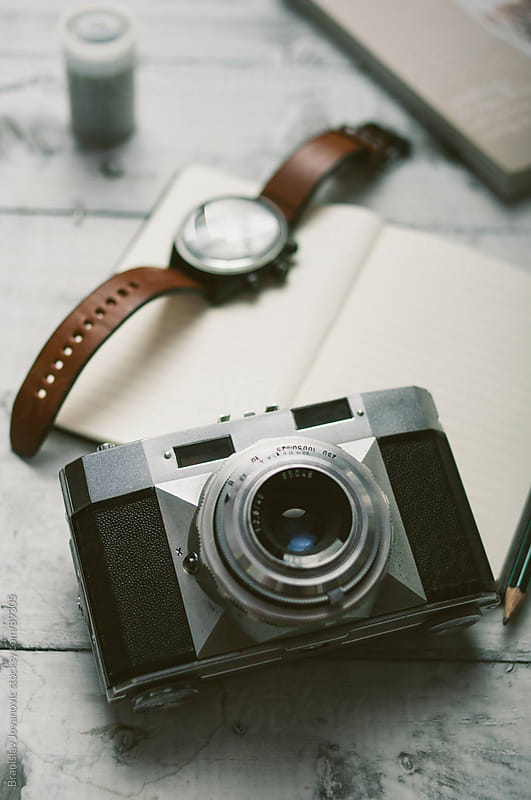 Retro camera on the Table  by Brkati Krokodil for Stocksy United