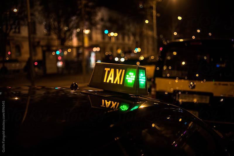 Taxi sign at night. Barcelona by Guille Faingold for Stocksy United