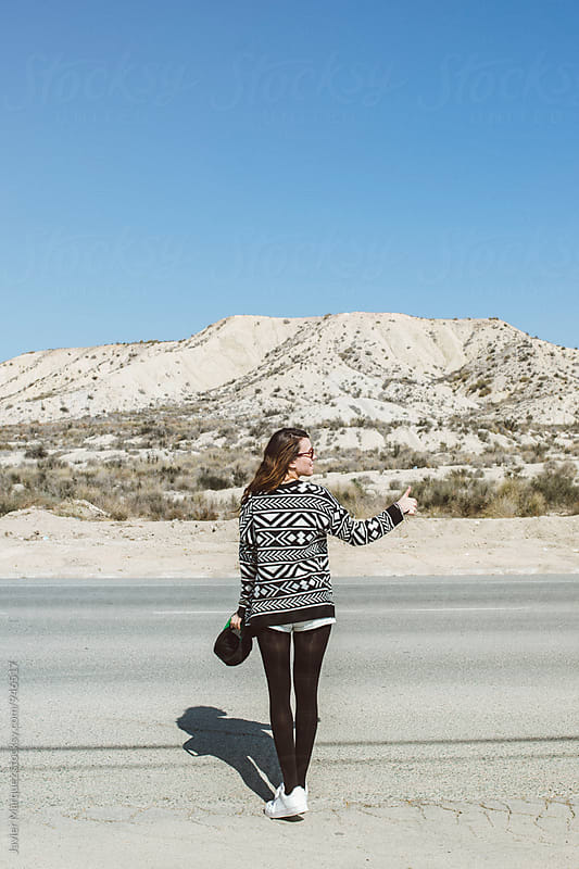 Young girl travels to hitch-hike by Javier Marquez for Stocksy United