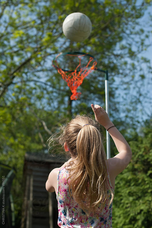 Young girl playing netball by CHRISTINA K for Stocksy United