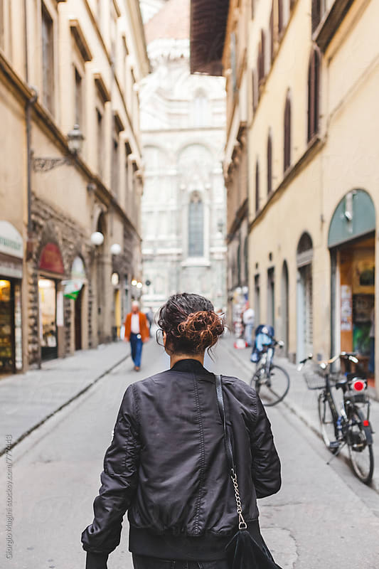 Young Woman Walking Through the Street of Florence in Italy by Giorgio Magini for Stocksy United