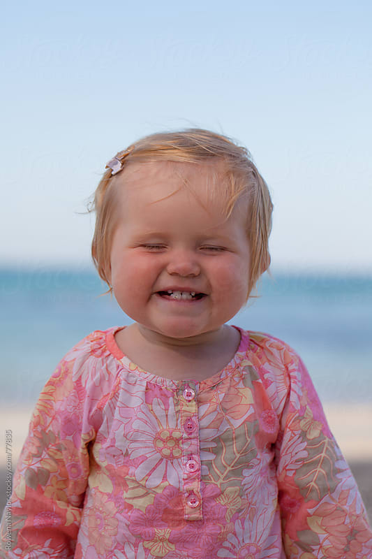 Happy Toddler at the Beach in Summer by Rowena Naylor for Stocksy United