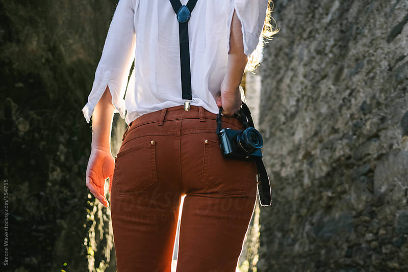 Young woman with suspenders from behind by GIC for Stocksy United
