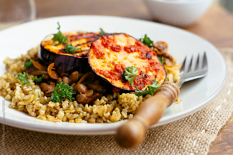 Middle-eastern freekeh lentil and harissa eggplant by Harald Walker for Stocksy United