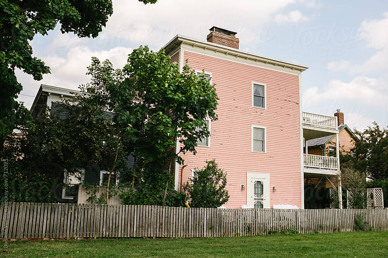 Classic pink American maritime houses in New England. by J Danielle Wehunt for Stocksy United