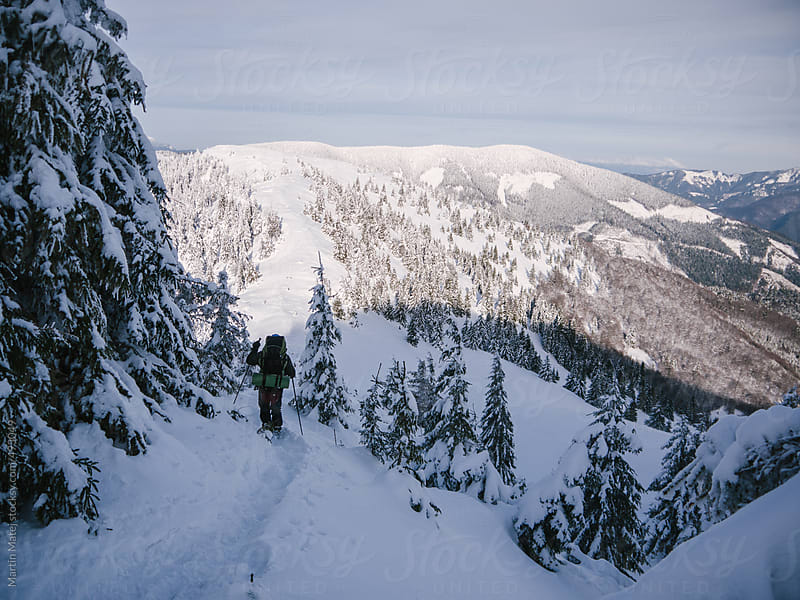 Winter backpacking with sunny hill ahead by Martin Matej for Stocksy United
