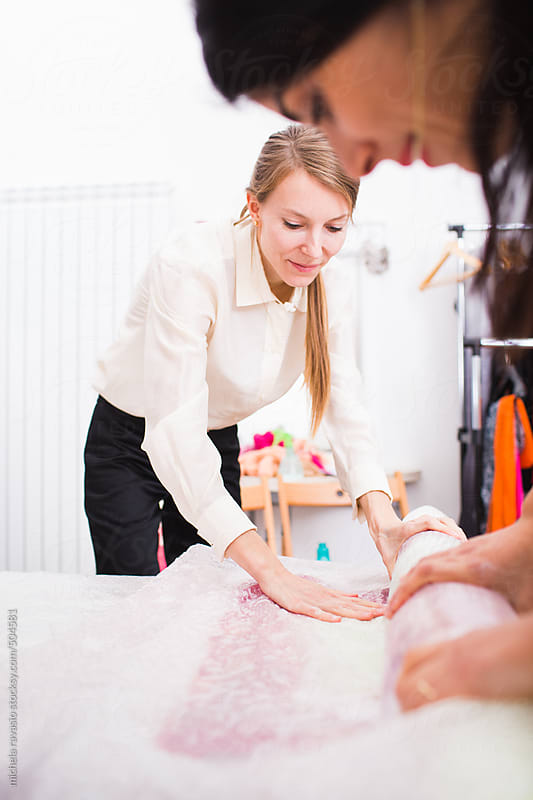 Young fashion stylist women at work by michela ravasio for Stocksy United