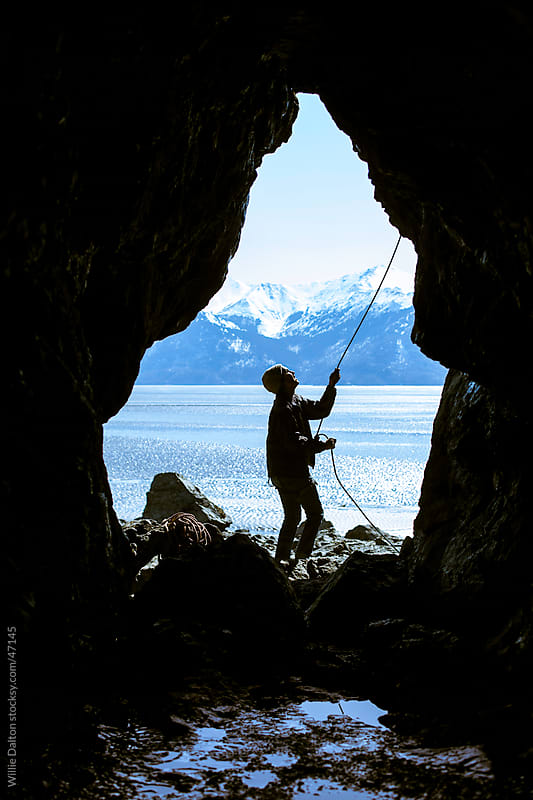 Silhouette of A Climber Belaying  by Willie Dalton for Stocksy United