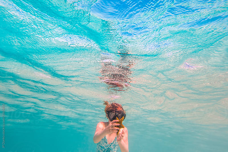 Little Girl Finding Starfish Swimming Underwater at All Inclusive Caribbean Resort White Sand Beach by JP Danko for Stocksy United