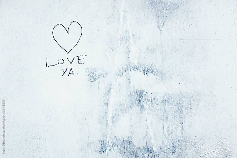LOVE YA painted on exterior of building wall by Paul Edmondson for Stocksy United