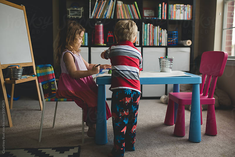 Brother and Sister working together  by Courtney Rust for Stocksy United