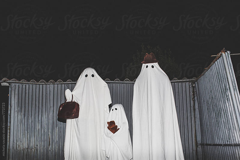 Family ghosts ready to go out at night by michela ravasio for Stocksy United