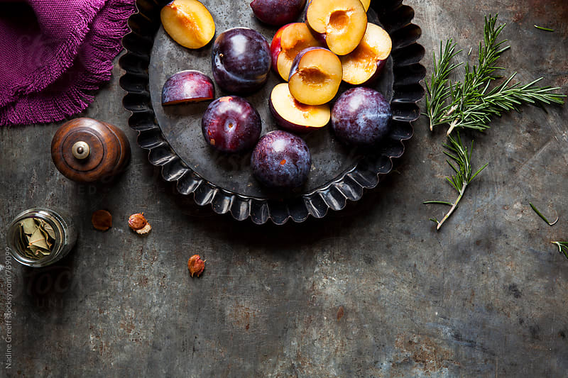 Fresh plums and cooking ingredients by Nadine Greeff for Stocksy United