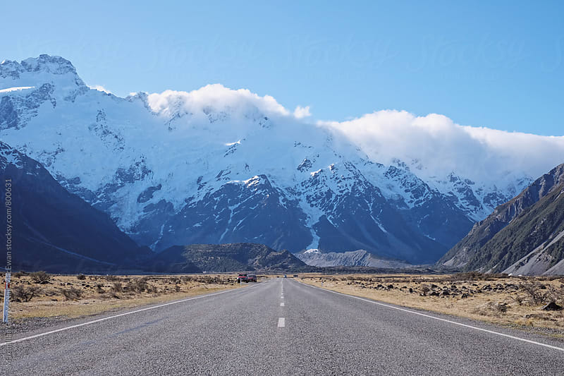 Road leading to the mountains and adventure by Maximilian Guy McNair MacEwan for Stocksy United