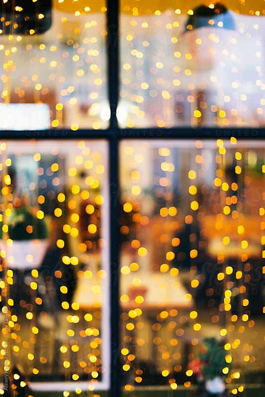 Christmas lights in the window by Alexey Kuzma for Stocksy United