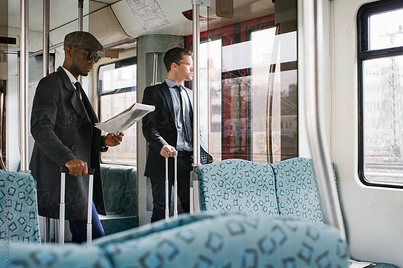 Two Business Travelers Commuting in Urban Train by Julien L. Balmer for Stocksy United