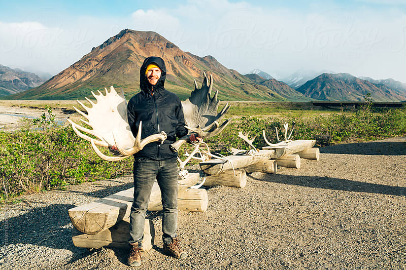 Moose Antlers In Hand by Luke Mattson for Stocksy United