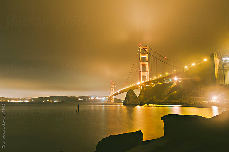 Foggy San Francisco's Golde Gate at Night by Oscar Lopez for Stocksy United