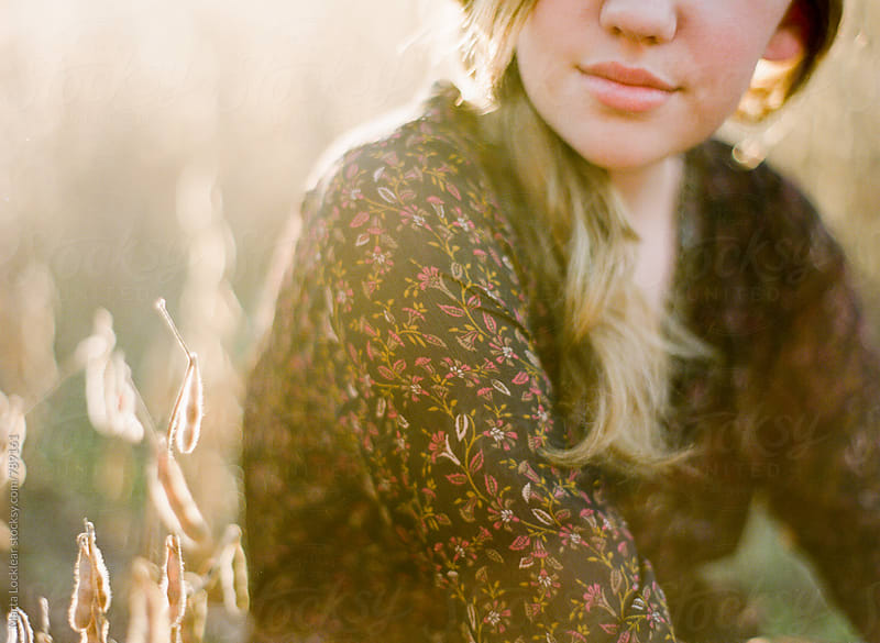 Soft detail of a smiling girl by Marta Locklear for Stocksy United