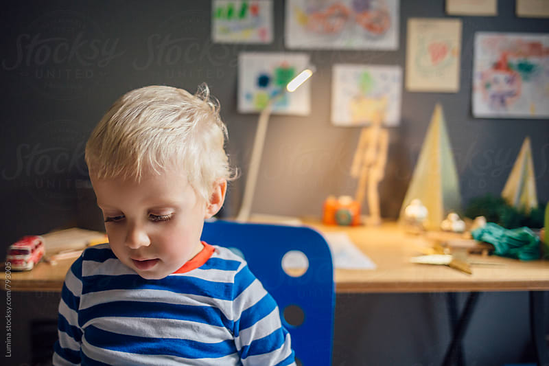 Adorable Blond Boy in Striped Pajamas by Lumina for Stocksy United