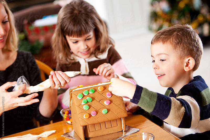 Gingerbread: Kids Having Fun Baking at Christmas by Sean Locke for Stocksy United