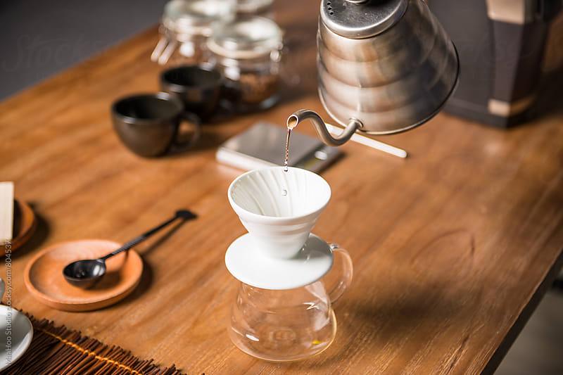 Man preparing Steaming Filter Coffee by MaaHoo Studio for Stocksy United