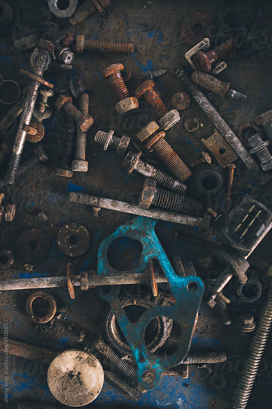 scrap screws in vehicle repair plant by zheng long for Stocksy United