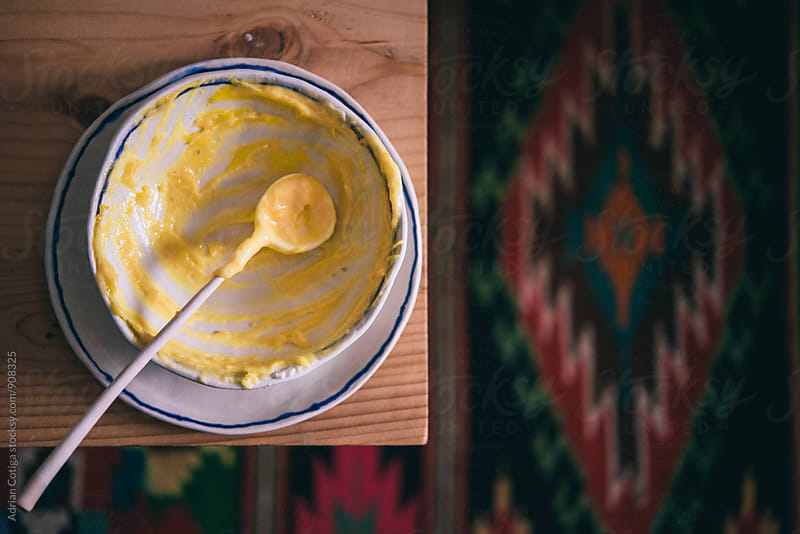 Cream leftover in a bowl by Adrian Cotiga for Stocksy United