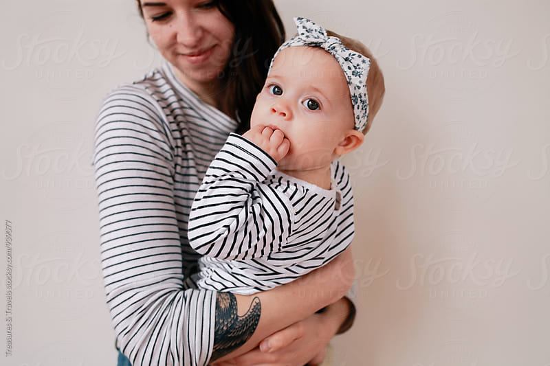 woman and baby wearing matching outfits by Treasures & Travels for Stocksy United
