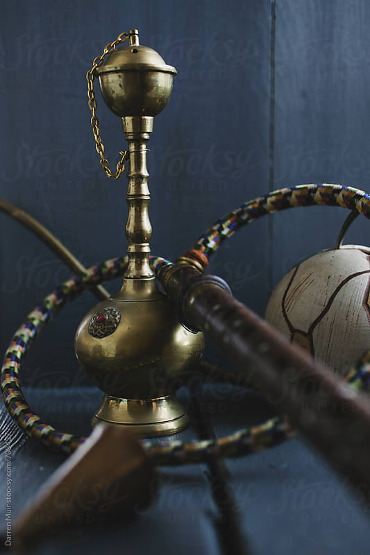Hookah ready for use.  by Darren Muir for Stocksy United